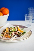 Warm rice salad with salmon, clementines and a creamy dill sauce