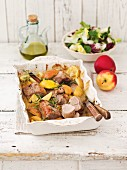 Baked pork fillet with apples, honey and lemons
