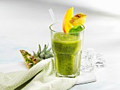 A spinach smoothie with exotic fruits