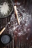 A tartlet tin, flour and baking utensils