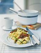 Scrambled eggs with kippers and lemons