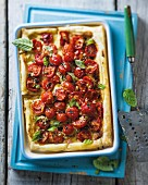 A tomato and basil puff pastry tart