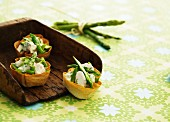 Pastry shells filled with asparagus salad