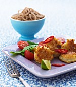 Fish balls with mange tout, chillis, tomatoes and wholemeal spaghetti