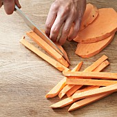 Sweet potato being cut into chips