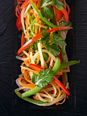 Pepper salad with carrots and coriander leaves (seen from above)