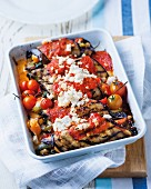 Aubergine rolls filled with ricotta, tomato sauce