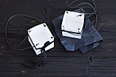 Small carrying boxes made from white cardboard as gift boxes