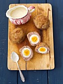 Scotch eggs with a horseradish sauce