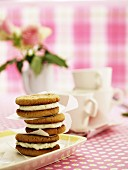 A stack of oat sandwich biscuits filled with cream cheese