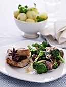 Pork steak with star anise, mushrooms, soy sauce and broccoli florets