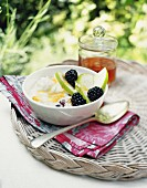 Bircher muesli with apples and blackberries