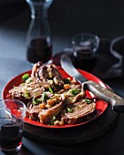 Stuffed neck of lamb with cheese, almonds and sultanas
