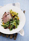Slices of roast veal with a colourful salad and new potatoes