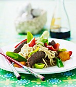 Noodles with pepper, leek, beef and soy sauce