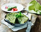Spinach polenta in an aluminium pan