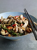 Stir-fried chicken with cashew nuts and mushrooms