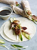 Chinese pancakes with duck, cucumber and plum sauce