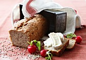 Sliced spiced bread and Camembert bread with radishes