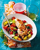 Salmon with a warm tomato salad