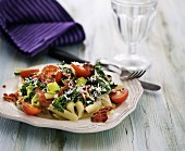 Penne with green kale, bacon and tomatoes