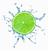 A slice of lime with splash of water