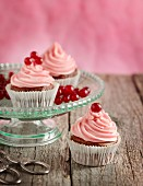 Cupcakes with pink butter cream and redcurrants