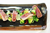 Fried tuna fish slices with grapefruit and avocado