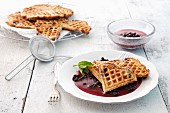 Waffles with Blueberry Sauce on a Plate with Fork