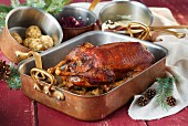 Stuffed Christmas goose in a roasting tin