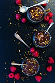 Vegan chocolate mousse with raspberries and orange zest