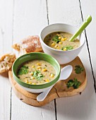 Sweetcorn and coconut soup with lemongrass in two bowls