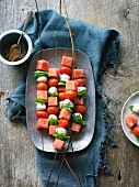 Watermelon skewers with mozzarella, tomatoes and basil (seen from above)