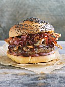 A hamburger with bacon and mushrooms