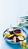 Pina colada ice cream sticks with chocolate glaze