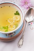 Clear broth with pancake rolls for Passover