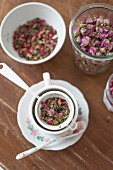Brewing an infusion of dried rose petals