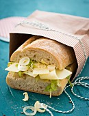 Ciabatta sandwich with cheese, onion and lettuce