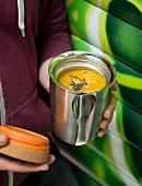 Pumpkin soup in an insulated container