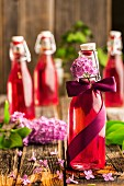 Bottles of lilac flower syrup