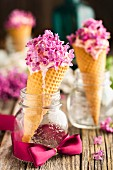 Vanilla ice cream with lilac flowers in cones