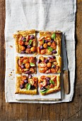 A cocktail tomato and olive tart