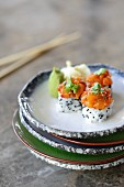 Rice canapés with black sesame seeds and salmon tatar