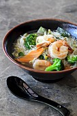 Rice noodle soup with king prawns