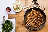 Fried smelts with potato salad and beans