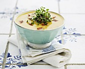 Potato soup with bacon and herbs