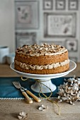 A coffee and walnut cake on a cake stand