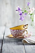 A coffee cup and spring flowers