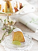 A slice of almond and lime cake on a glass plate