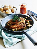 Turkey escalopes with an olive marinade on skewers served with salted potatoes and mojo sauce